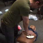 Bonnie - Dan giving CPR with AED patches